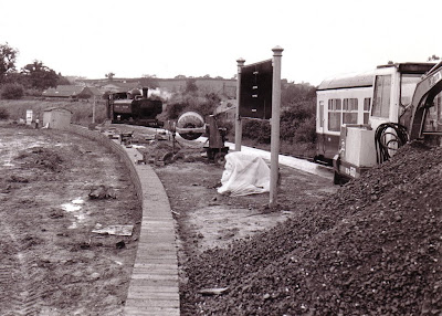 After arriving with the 12.15 from Buckfastleigh, 5764 runs round it's train in the rain at Littlehempston to depart with the 12.50 return. Work on the second platform is in evidence in the foreground 11th June 1993.  Photo: Tim Edmonds