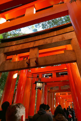 Beginning of the thousands of Torii Gates at Fushimi Inari shrine, which shortly will turn into with two dense, parallel rows of gates called Senbon Torii (