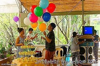 My nephews and niece putting up colorful balloons at the venue