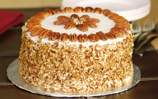 Best Ever Carrot Cake with Toasted Pecans on a cake board