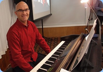 Warren Levick playing the Club's Yamaha Clavinova CVP-509. Photo courtesy of Dennis Lyons.