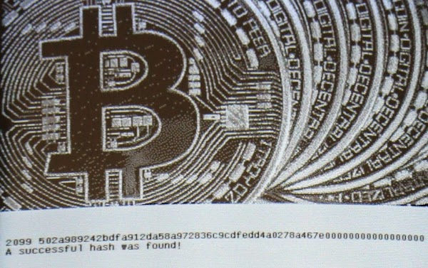 The algorithm found a successful hash, indicated by all the zeros at the end. Bitcoin graphic source probably MoneyWeek.