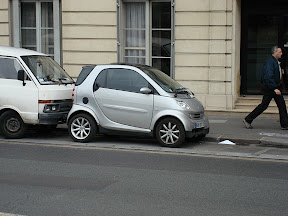 These Smart cars are everywhere! Notice how close the guy behind him is parked?  Usually, there is a car in front parked equally as close!