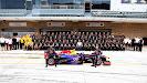 The team of Red Bull Racing with Mark Webber and Sebastian Vettel