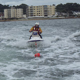 16 August 2014 - Poole ILB towing a jet ski after it had gone to assist a capsized sailing dinghy, upturned and threw its two occupants into the water. Photo: RNLI Poole/Dave Riley