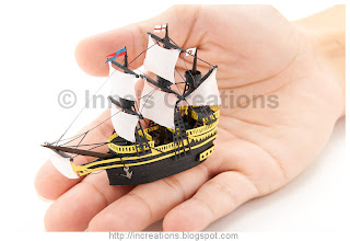 Miniature galleon in a hand
