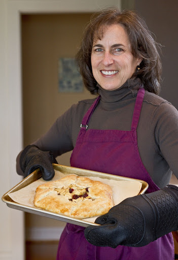 Barbara Schwartz with her apple and pear galette, at her home in Madrona [Seattle Times/Dean Rutz/Nov 2011]