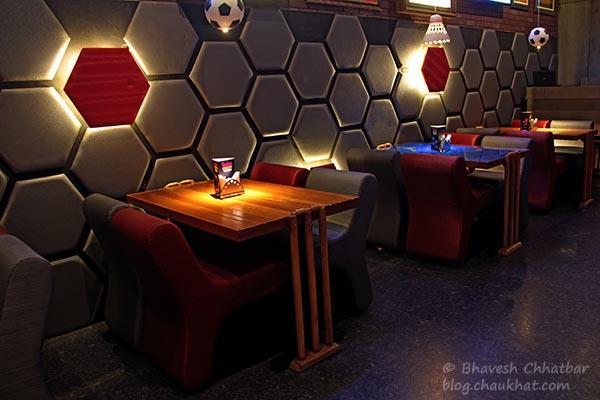 Sports-themed seating arrangement at Toss Sports Lounge Koregaon Park