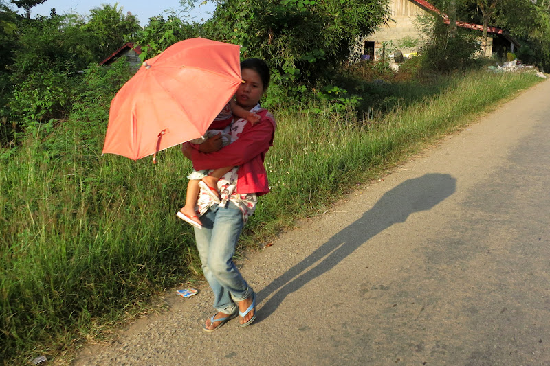 Woman with baby and umbrella