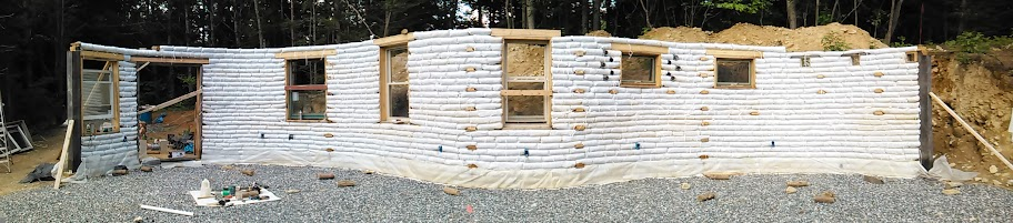 Cheap earthbag house foundation natural building forum for Cheapest way to build a house foundation