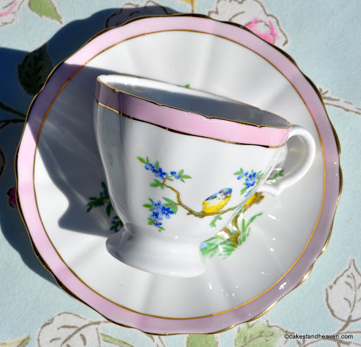 White bone china with pastel pink and gold border