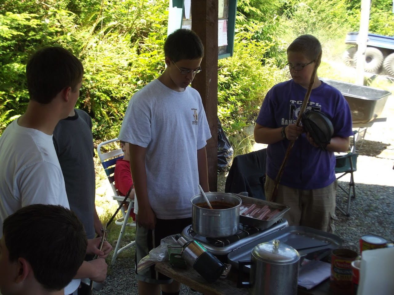 Cooking hotdogs and chili in camp (they were delivered frozen)