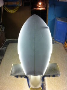 this is 2,38 thick by 20.25 wide. With two wings to bring the tail in. Custom and available in all shapes and sizes.