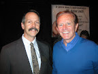 Ross Bannister matches his smile to that game-show-host smile of Bob Eubanks, right.
