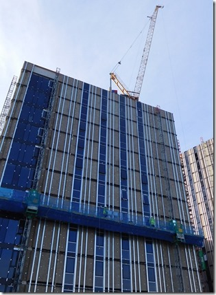 2 work platform going up tower block