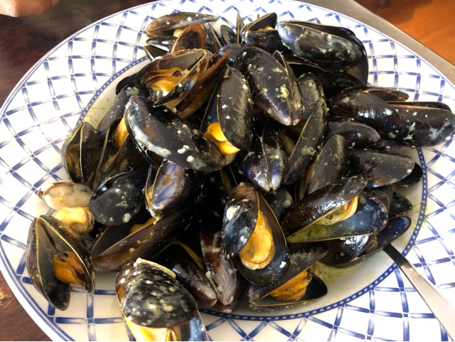 Steamed local mussels with fresh basil and lemon butter sauce