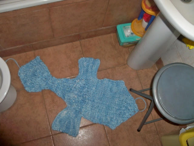 knitted big fish in the bathroom floor