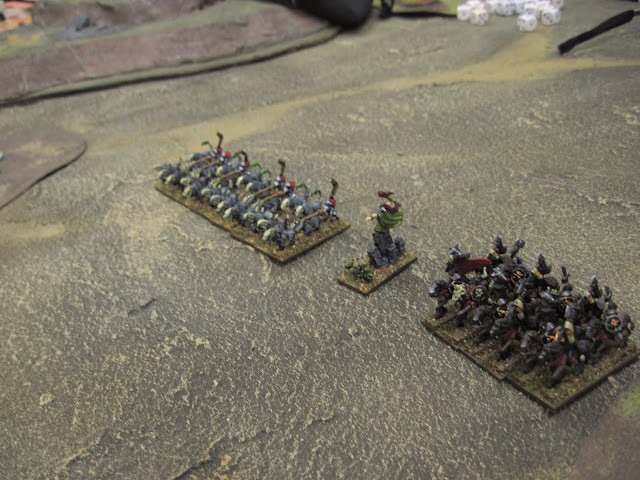 A Sorceror of Nurgle orders the hounds forward.