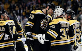 Zdeno Chara, Tim Thomas and the Bruins celebrate their win over the Ottawa Senators