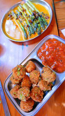 Mixed Dal, Fava Bean and Paneer Pakoras with Rhubarb Strawberry Achaar, and a Grilled Asparagus with a rich curry made with fresh tumeric, green garlic, and cream topped with a sweet raisin and almond chutney from Bollywood Theater