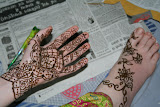 A PV gets her hand and foot decorated with mehndi
