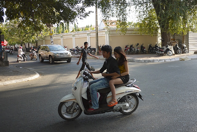 young man and young woman on a motorbike
