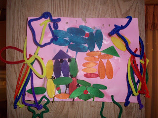 Untitled creation made w/colored wood pieces and pipe cleaners.