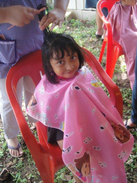 Both children and adults were given free, professional haircuts. That's something to smile about!
