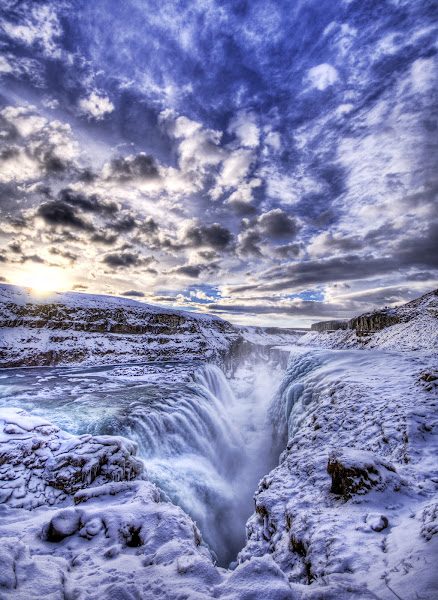 Photo: The Icy Pit to Hell - Gulfoss, Iceland  This is Gulfoss, the frozen waterfall in Iceland. Dark age theologians used to believe this was the entrance to hell, which was originally a cold place; the innermost circle of Dante's version was frozen. True believers would come here and cast themselves down into the chasm to try to rescue souls they were told had gone to hell.  From Trey Ratcliff at stuckincustoms.com