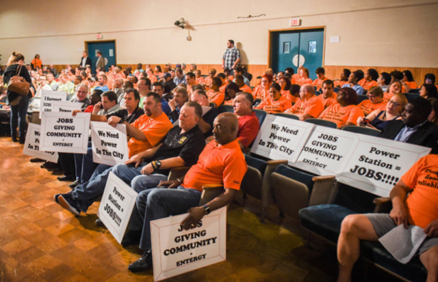 "In October 2017, about 50 people in bright orange shirts filed into New Orleans City Hall for a public hearing on Entergy's request to build a $210 million power plant in eastern New Orleans. It was easy to tell who supported Entergy's proposed power plant at a public hearing last fall; they were the ones wearing fluorescent orange shirts that read ""Clean Energy. Good Jobs. Reliable Power."" Some of those people were professional actors paid to show up and support the plant. Photo: Michael Stein / The Lens"
