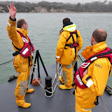Steve providing the coxswain with a guide to the distance to go to a mooring buoy.  6 April 2014 Photo: RNLI Poole/Anne Millman