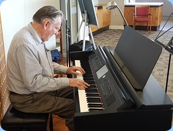 Roy Steen playing the Village's Yamaha Clavinova CVP-709
