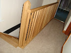 Bishops mitre newel top and landing balustrade in oak
