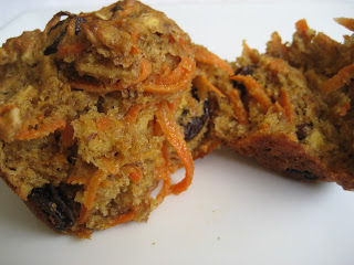 Muffin broke in two to show inside with carrots and raisins.