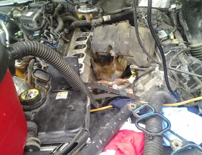 Lincoln Town Car 46L 2007 water in plug well - Lincolns OnLine