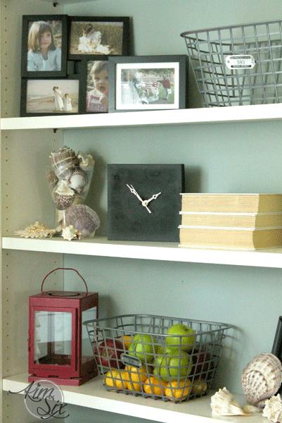 Square stone clock on shelf