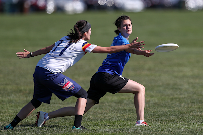 Photo shows Rhona pivoting during an Ultimate game at WUCC 2018