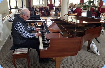 George Watt playing the Steinway piano.