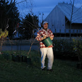 John Picard carries one of the plants.