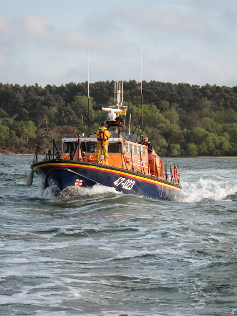 Poole ALB heading past Brownsea Island in Wills Cut - fenders at the ready to come alongside Dolphin III -  22 April 2014 Photo: RNLI Poole/ Anne Millman