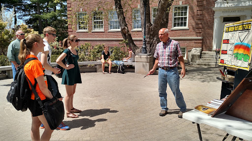 Eric engaging with a small crowd at the University of New Hampshire.