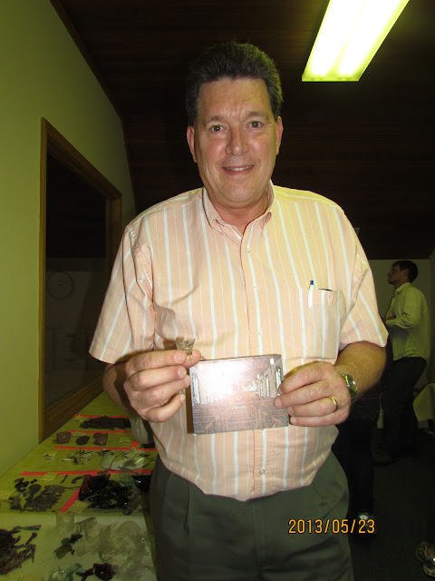 Orchard Lake Community Church, Presbyterian Pastor Paul Thwaite with found communion glass & early photo of church, 2013.