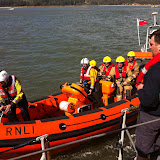 20 April 2012 - As the day wore on, with low tide at the jetty on Green Island, firefighters were brought to the all-weather lifeboat as a staging post before transfer onto PHC's Vanguard for the trip back to Poole after their firefighting shift. Photo: RNLI/Poole Lifeboat Station Dave Riley