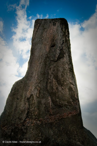 A low angle shot of a standing stone