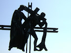 Stations of the Cross Outside: Simon helps Jesus to Carry His Cross