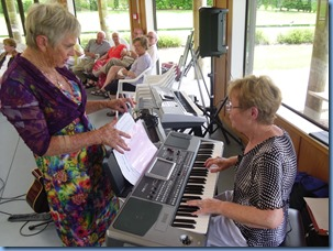 Our Events Manager, Diane Lyons, playing her Korg Pa900 with Jeanette Harding making sure her music did not blow away with the gentle through breeze.