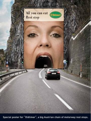 mobil masuk terowongan yang ditempeli iklan seolah-olah masuk mulut