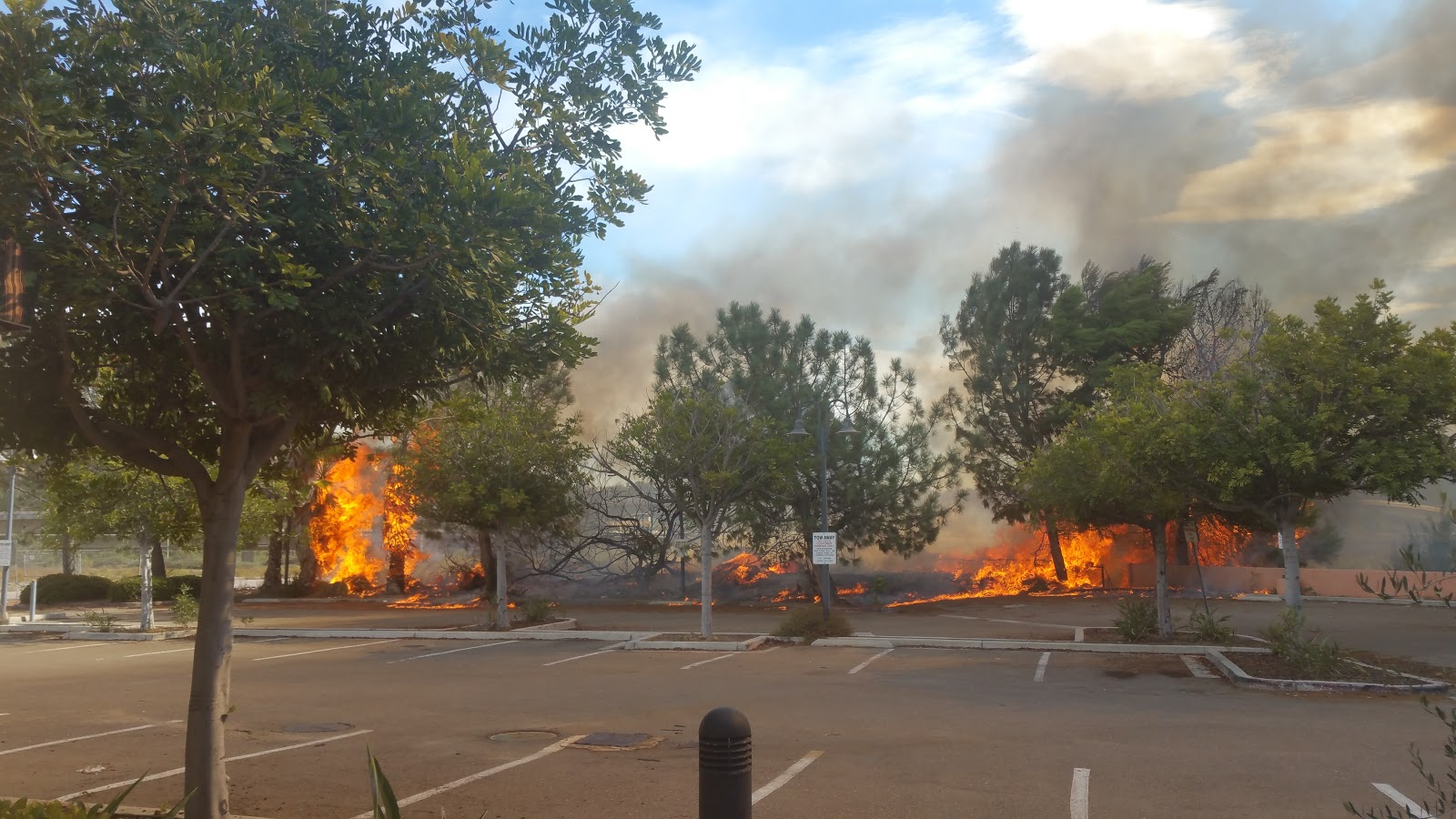 Fire in a small restaurant  parking lot.