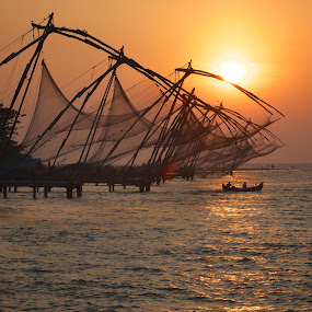 fishing nets by Mike Mulligan - Landscapes Waterscapes ( water, men at work, sunset, india, fishing,  )