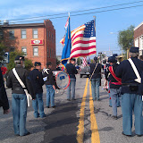5th MI Regimental Band prepares to march down Main Street of Plymouth MI